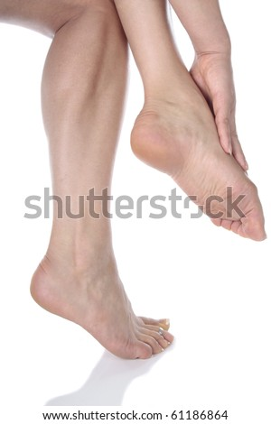 Woman  legs and feet  over white background - stock photo