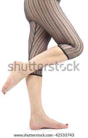 Woman legs and feet with  tights  and shoes over white