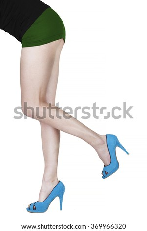 Woman legs and shoes on white background