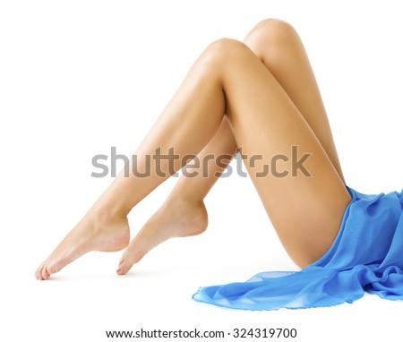 Woman Legs Body Beauty, Slim Leg Smooth Skin, Girl in Blue Dress Lying on White background - stock photo