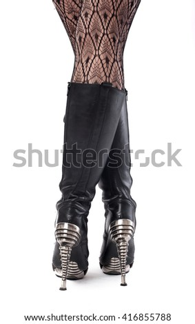 Woman Legs. Closeup of female legs in black nylon stockings and high heel shoes - stock photo