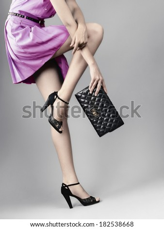 woman legs in black high heels shoes - stock photo