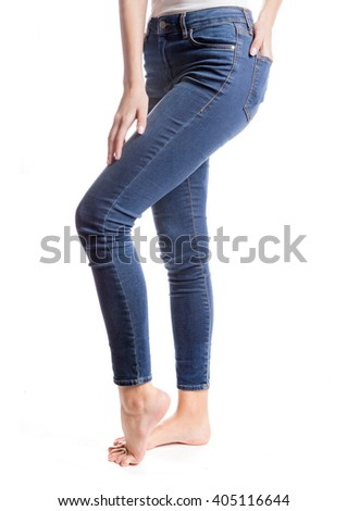 Woman legs in blue jeans with white background.
