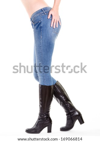 Woman legs in boots isolated on white - stock photo