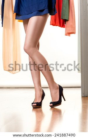 Woman legs in new shoes on high heels in the wardrobe - stock photo