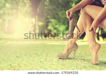 woman legs in park and shoes  - stock photo