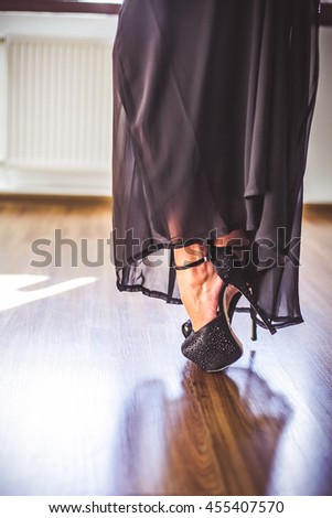 Woman legs in stylish black shoes