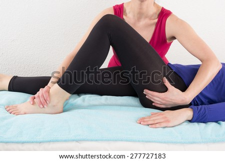 Woman legs massage at spa center given by a woman therapist