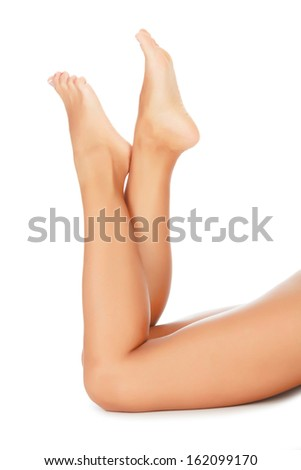 Woman legs on white background, copyspace  - stock photo