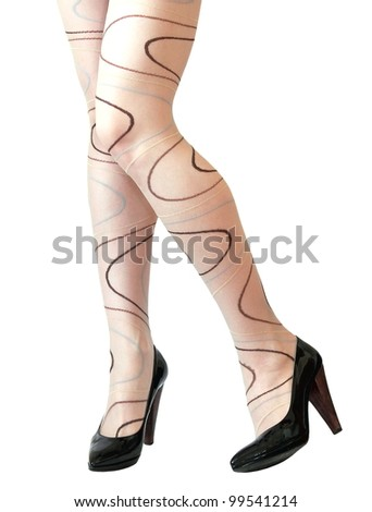 Woman legs posing in modern high heels leather shoes isolated on white background - stock photo