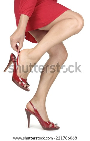 Woman legs red dress and heels over white - stock photo