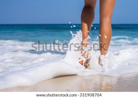 woman legs, walking on the beach - stock photo