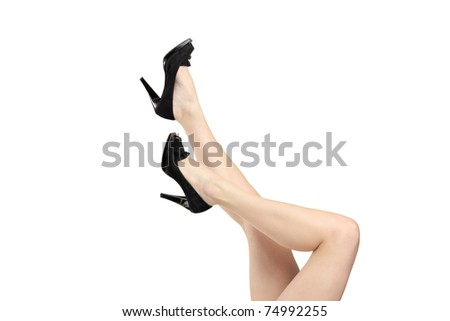 Woman legs wearing black high heels shoes isolated on white background - stock photo