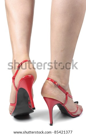 Woman legs wearing red heel shoes isolated over white background