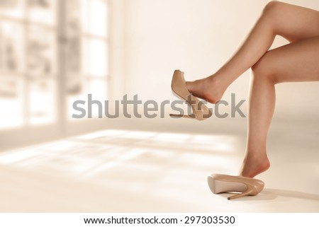 woman legs window and sun  - stock photo
