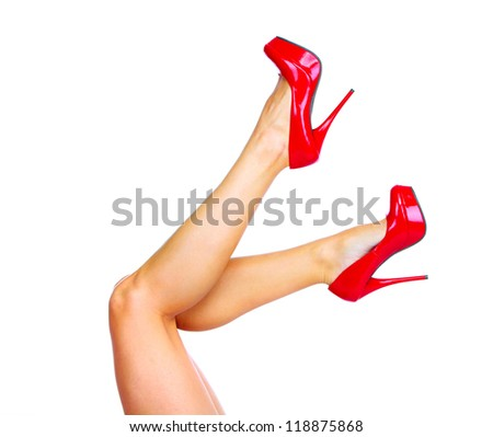 Woman legs with a red sexy shoes. Isolated on white background. - stock photo