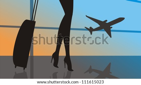 Woman legs with baggage