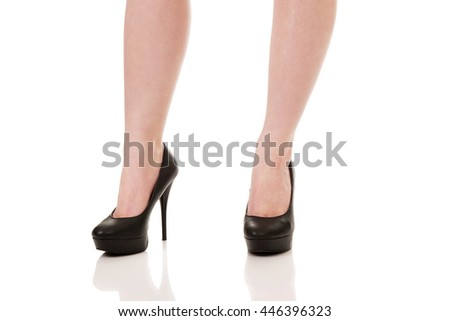 Woman legs with black sexy shoes. .