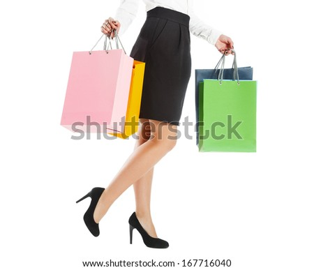 Woman legs with colorful packages