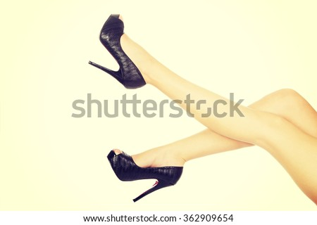 Woman legs with high heels. - stock photo