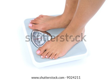 Woman legs with  scales on  isolated background
