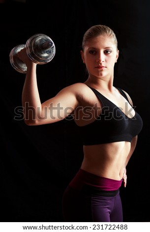 woman lifting weights - stock photo