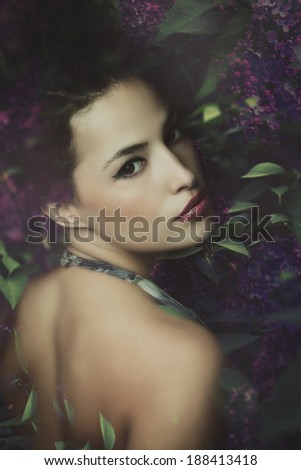woman like a fairy in lilac flowers, composite photo