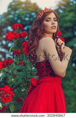 Woman like a princess in an vintage red dress