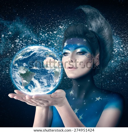 Woman like moon inspired bodyart and hairstyle holding planet earth in hand with care. Element of this planet furnished by NASA - stock photo