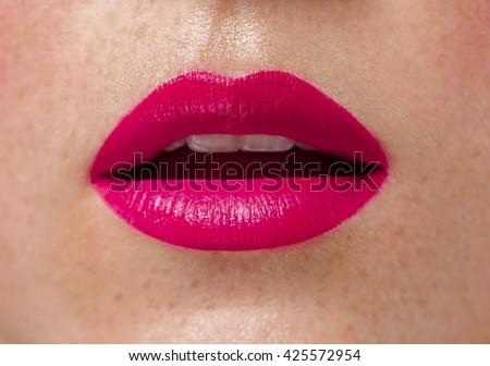 Woman lips close up pink lipstick - stock photo