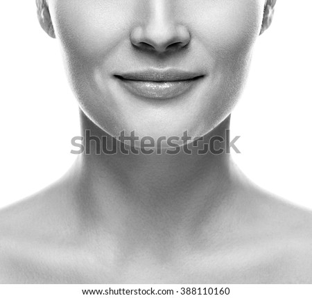 Woman lips nose neck smile black and white close-up - stock photo