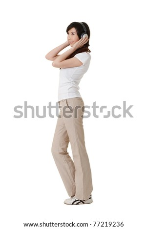 Woman listen music by headphone, full length portrait isolated on white background. - stock photo