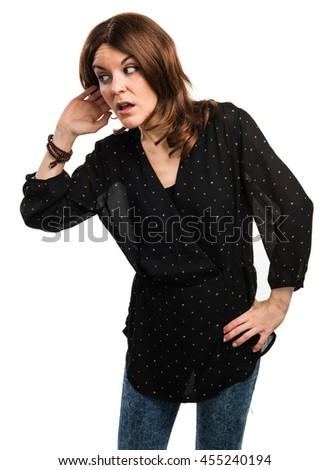 Woman listening something - stock photo