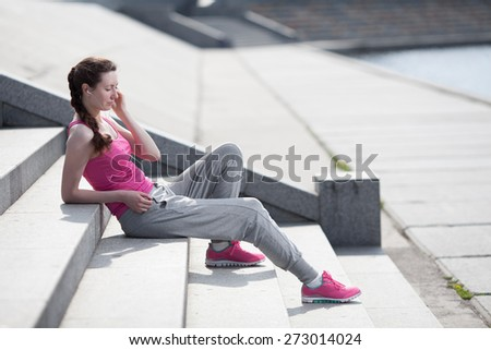 Woman listening to mp3 player and wearing sports wear