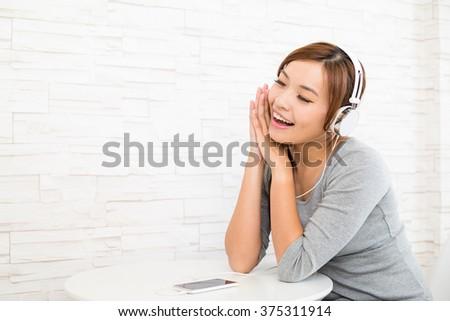 Woman listening to music - stock photo