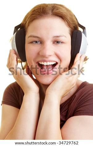 Woman listening to music and singing along - stock photo