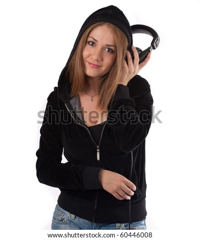 Woman listening to music at a  headphone smiling ,isolated on white - stock photo