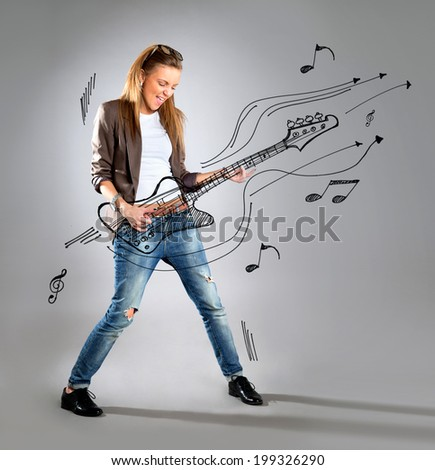 Woman listening to music on mp3 player, dancing playing air guitar. Funny happy portrait of business woman isolated on white background in full length. - stock photo