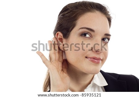 Woman listening with her hand on an ear isolated over white background - stock photo
