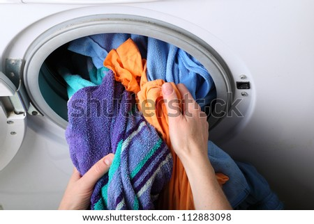 woman loading Preparation washing machine in bathroom clothes in the washing machine - stock photo