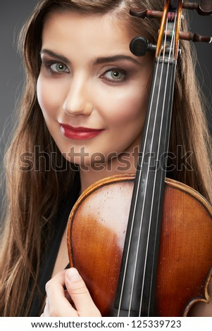 Woman long hair portrait isolated on gray background. Music violin. Female face close up.