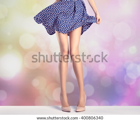 Woman long legs in fashion dress, high heels. Perfect female  sexy legs, stylish purple skirt and summer glamour shoes, colorful abstract background. Unusual creative elegant walking out outfit,people - stock photo