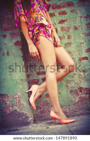 woman  long legs in  high heel shoes and summer dress outdoor shot - stock photo