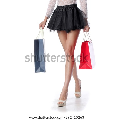 Woman long legs with two shopping bags, isolated on white