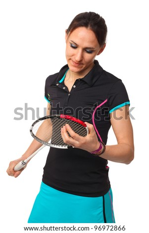 woman look her badminton racket isolated on white - stock photo