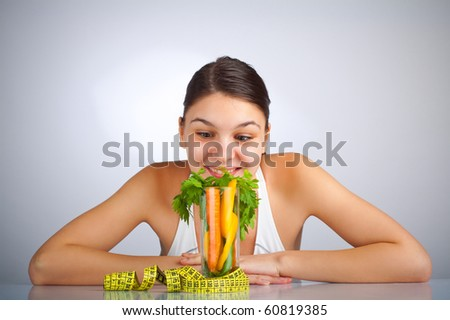 Woman looking at a glass filled with vegetables