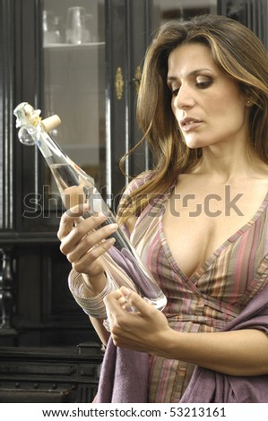 Woman looking at a grappa - stock photo