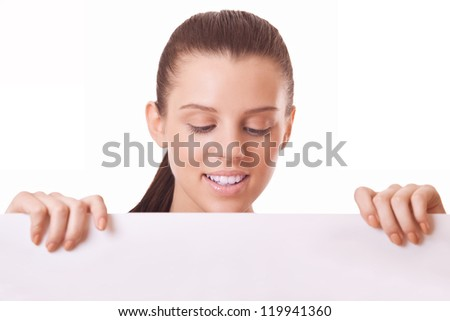 woman looking at blank board on white background - stock photo