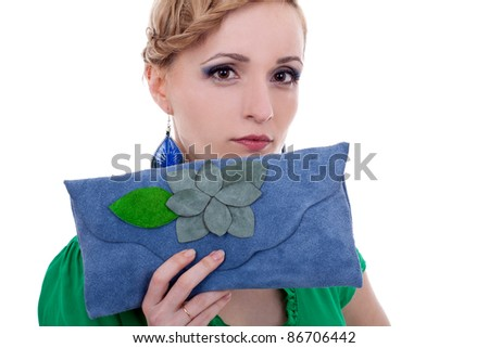 woman looking at camera and holding a small purse. Isolated on white background - stock photo