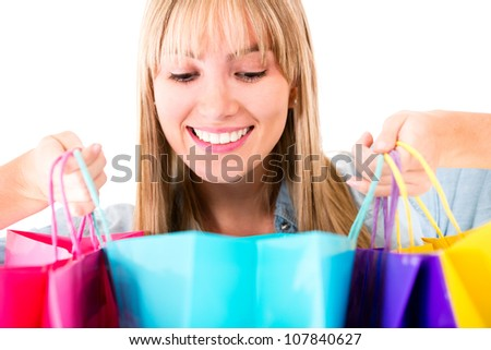 Woman looking at her purchases - isolated over a white background